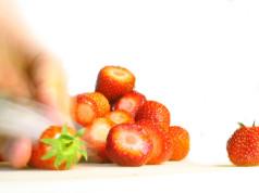 Hand Slicing Strawberries