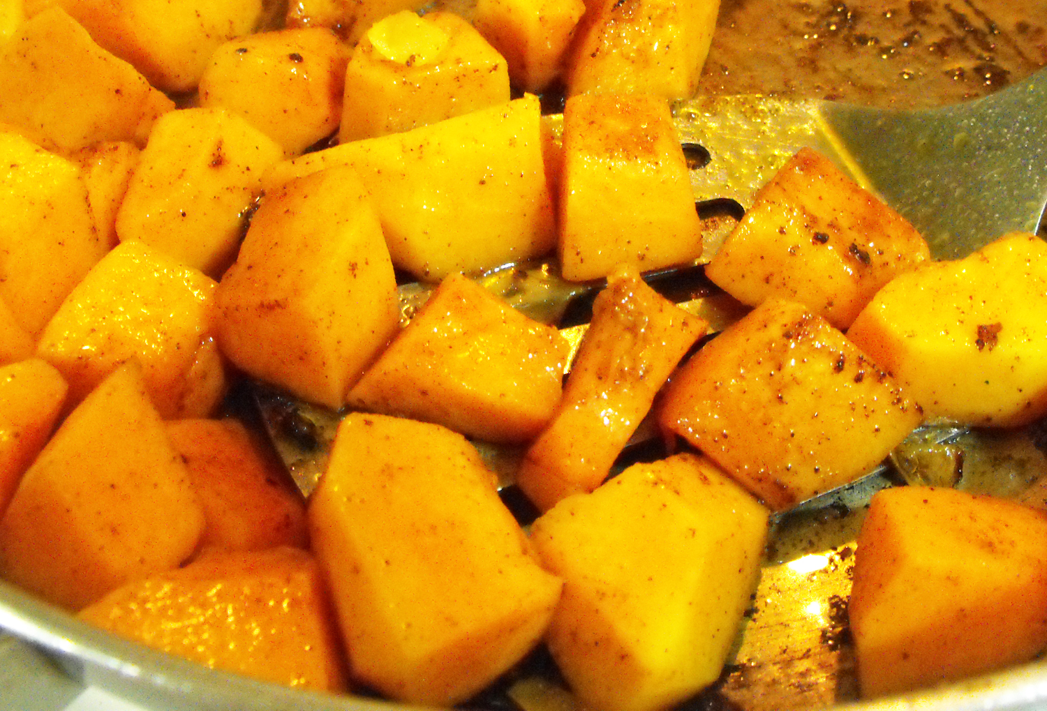 butternut squash being prepared in a skillet