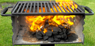 photo of lit coals on grill taken by Monica July 4th 2014